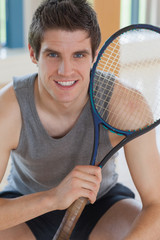 Man holding tennis racket