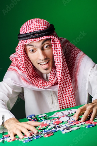 Arab playing in casino - gambling concept with man
