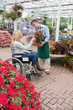 Woman in wheelchair buying a flower