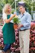 Florist explaining something to man