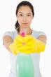 Brunette woman pointing spray bottle
