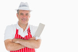 Smiling butcher with meat cleaver