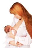 Mother breast feeding newborn baby and smiling
