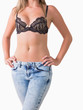 Woman in jeans and bra posing