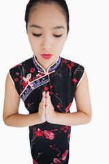 Woman wearing kimono with hands together