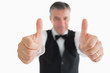 Cheerful waiter having thumbs up