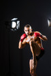 Boxer with studio lights in sports concept