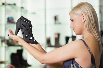 Woman looking at a shoe satisfied