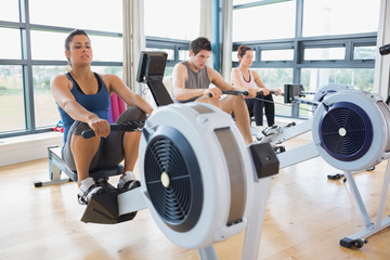 People working out on row machines