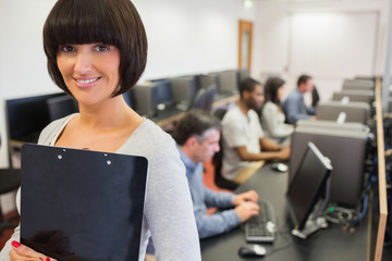 Teacher smiling in computer class