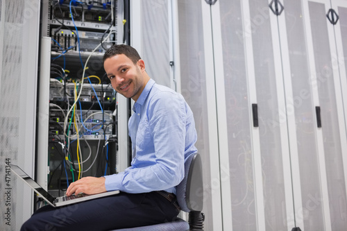 Smiling man working on the servers