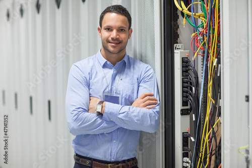 Technician standing next to the data store