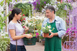 Customer talking to garden center worker