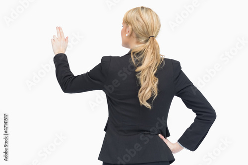 Standing businesswoman pointing something