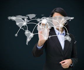 Businesswoman touching holographic world map