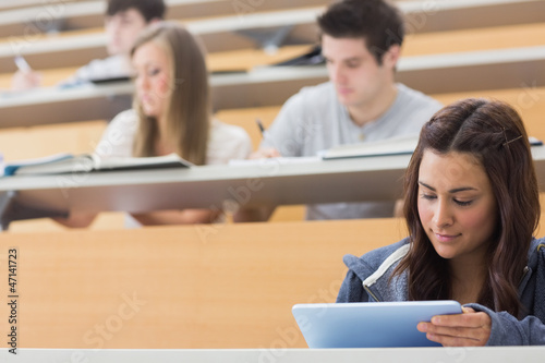 Student using tablet pc to take notes