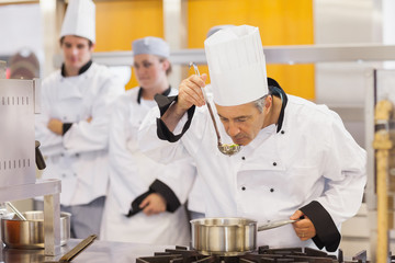 Chef tasting his students work