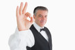 Happy waiter making OK sign