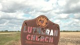 Lutheran Church Sign - Rusty Metal - Bullet Holes