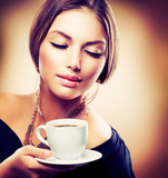Fototapety Beautiful Girl Drinking Tea or Coffee. Sepia Toned