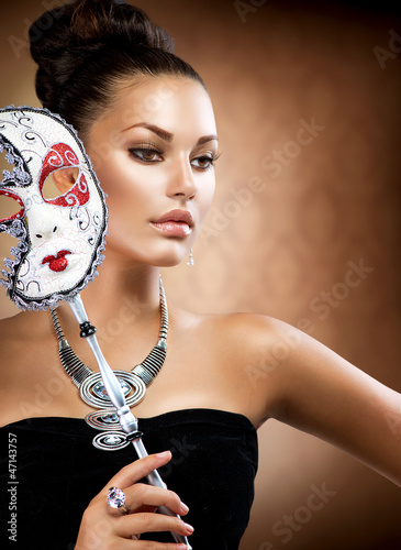Masquerade. Beauty Girl with Carnival Mask