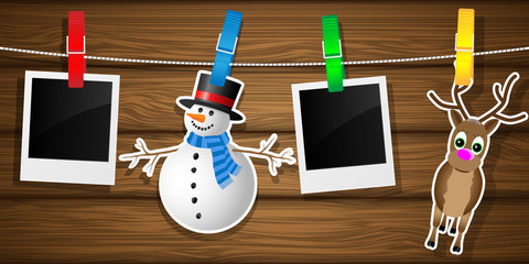 Snowman, reindeer and photo frame on the clothespin. Vector illu