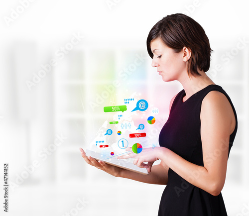 Young woman looking at modern tablet with colourful technology i