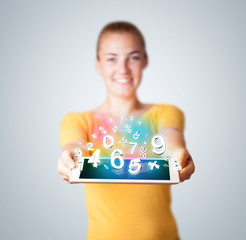Young woman holding tablet with numbers
