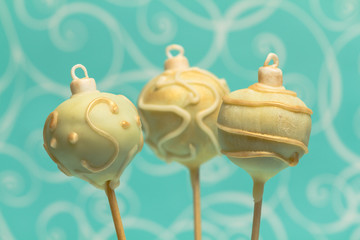 Christmas cake pops on turquoise background