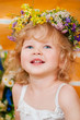 Beautiful little girl wearing a wreath