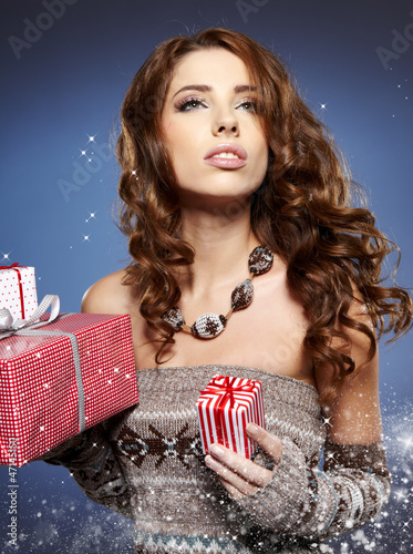 sexy girl smiles and holding a gift in magic packing