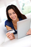 Brunette girl doing online shopping with digital tablet