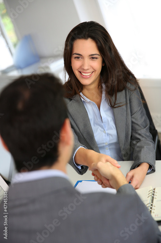 Business partners shaking hands after meeting