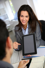 Businesswoman doing presentation on electronic tablet