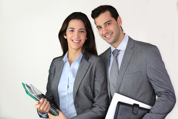 Portrait of smiling business people in grey suit