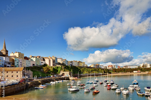 View of Tenby harbour against a blue summer sky.