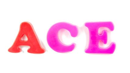 ace written in fridge magnets on white background
