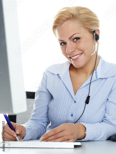 Charming girl with headset having a call