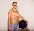 Beautiful Athlete with a Fitness Ball