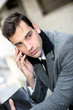 Trendy young businessman talking on mobile phone