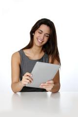 Smiling brunette girl websurfing with digital tablet