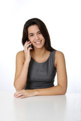 Smiling brunette talking on mobile phone