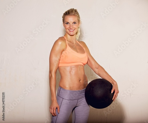 Pilates Instructor with Fitness Ball