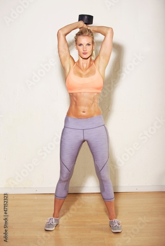 Athletic Woman Lifting a Dumbbell