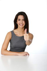 Smiling woman showing thumb up on white background