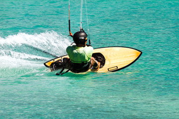 kite surfer in emerald water
