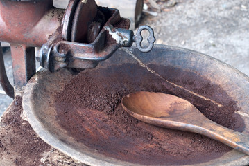 Roasted Arabica coffee grinding in old grinder in Mae Klang Luan