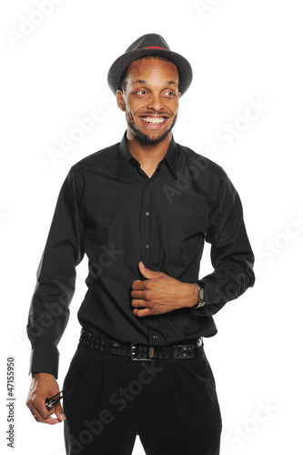 Young Black Man smiling and wearing a hat