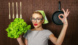 Happy woman cook with okay sign holding salad