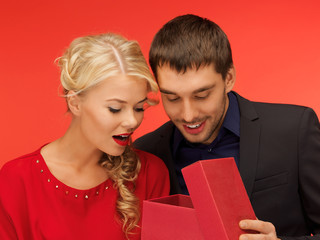man and woman looking inside the gift box